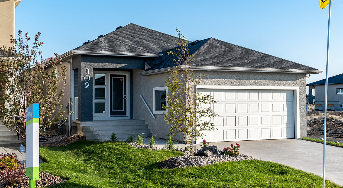 1. Front Exterior - 302 Tanager Trail - DG 23 B The Grayson Broadview Homes Winnipeg