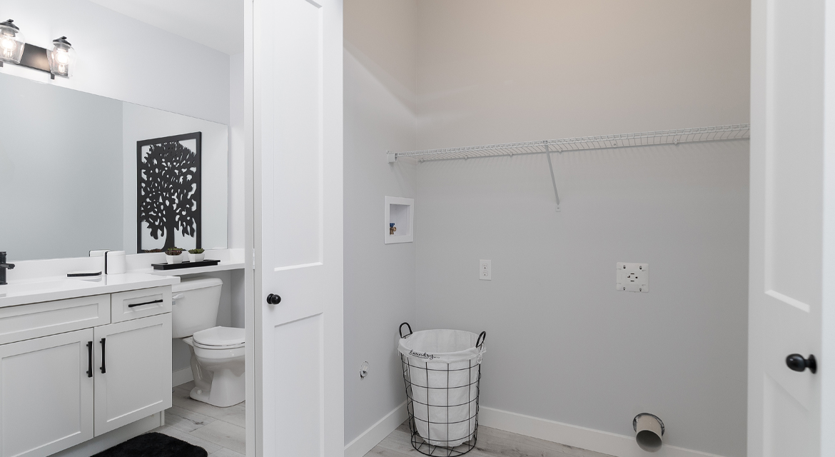 8. Powder Room and Laundry - 326 Tanager The Torres RG 106 D Broadview Homes Winnipeg