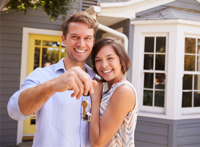 Couple holding keys in front of new house Stone Ridge Meadows Community Image