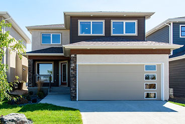 Contemporary Exterior With Stucco and Vinyl Siding with Cultured Stone