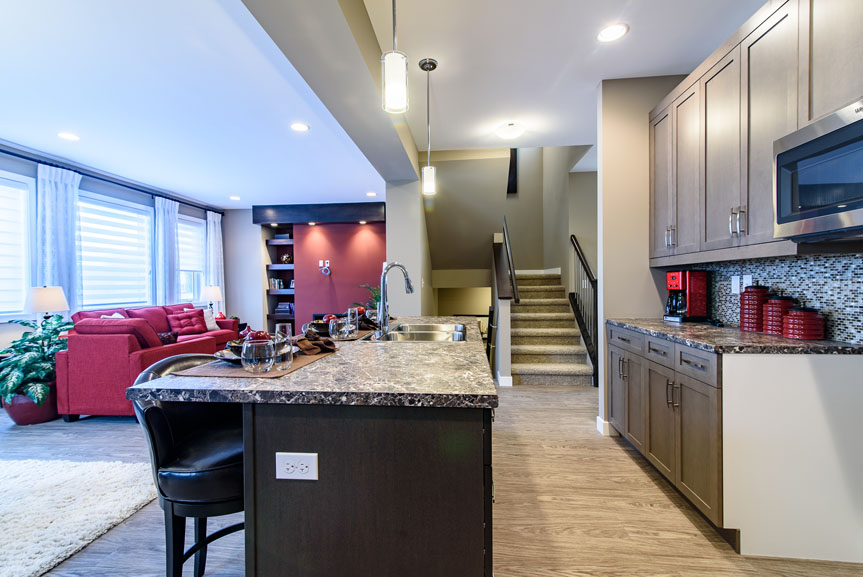 Contemporary Kitchen with Large Island with Eating Lip, vinyl plank flooring, Salem Solid Maple Thunder cabinets in island, Salem Solid Maple Winter cabinet at kitchen wall and ceramic tile backsplash