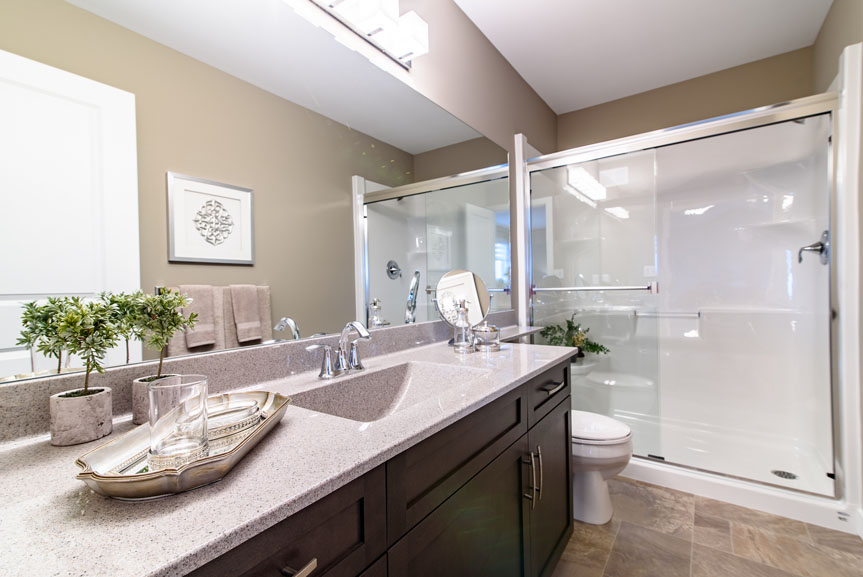 Contemporary Ensuite with fiber floor, Salem Solid Maple Thunder cabinets, laminate counter tops and beige walls