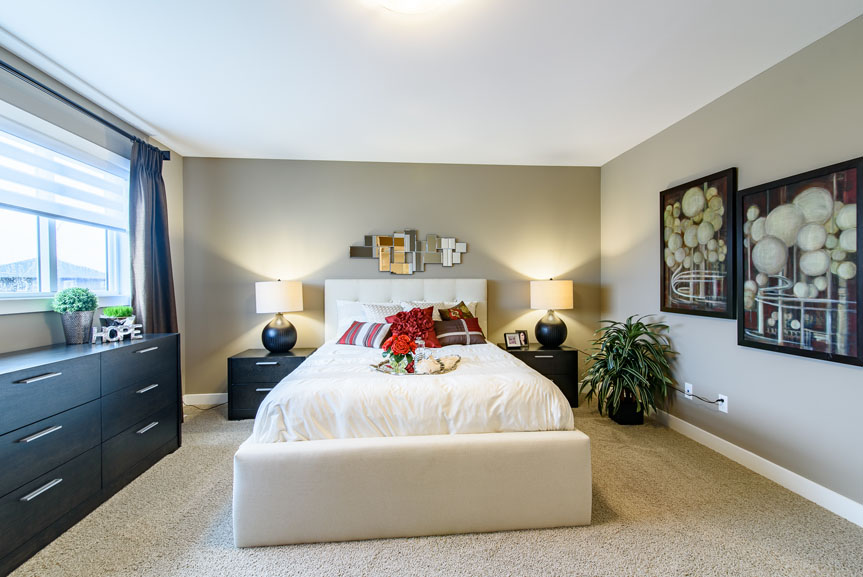 Contemporary Master Bedroom with Siesta Twist Pueblo carpet, beige walls and red accents
