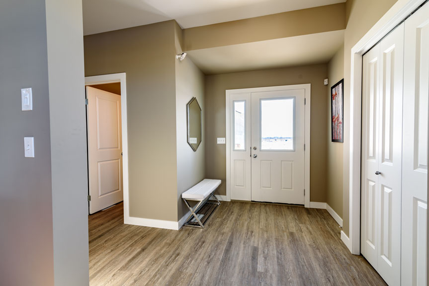 Contemporary Front Foyer with Vinyl Plank Flooring in Zodiac and MDF Casing and Baseboard