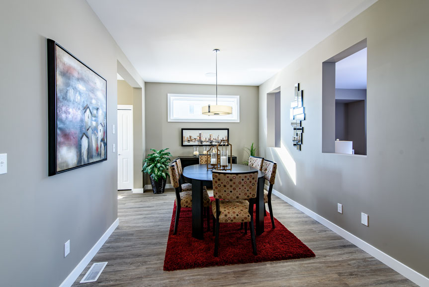 Contemporary Great Room with Vinyl Plank Flooring in Zodiac and MDF casing and Baseboards