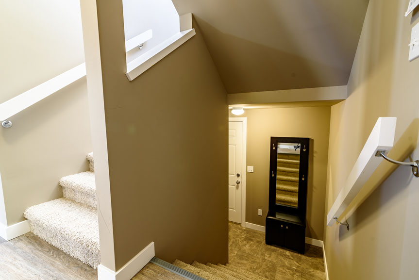 Private Side Entrance to Home with Vinyl Flooring