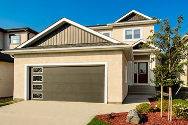 Contemporary Style Home Exterior with Stucco Finish and Board and Batten Vinyl Siding Gables