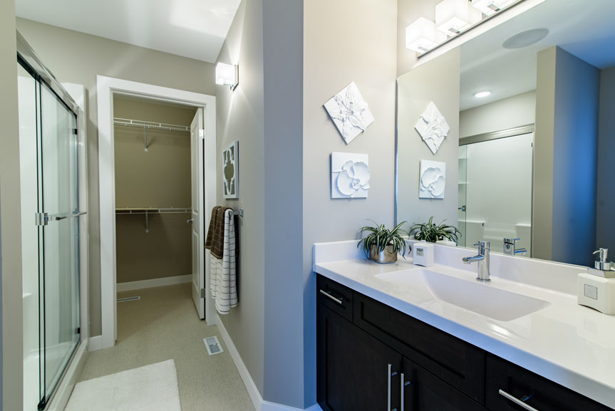 Contemporary Ensuite with Armstrong Cushionstep Vinyl Flooring, Salem Solid Maple Alabaster Cabinets and Cultured Marble Vanity Top