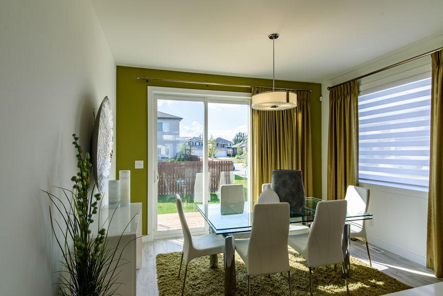 Open Concept Eating Area with Green Accent Wall