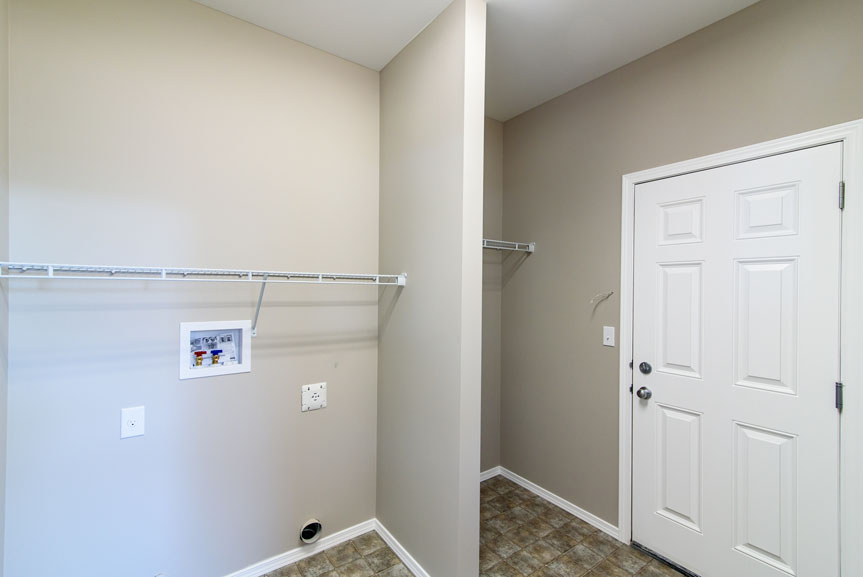 Mudroom with Laundry access and Initiator Vinyl Flooring and Garage Access