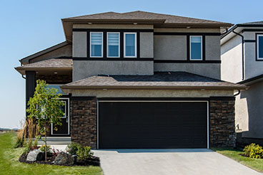 Contemporary home exterior with stucco and cultured stone details