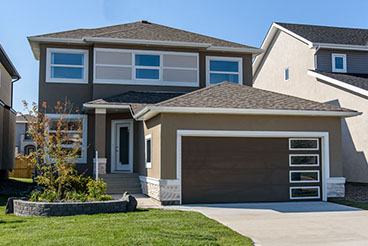 Contemporary Home Exterior with Acrylic Stucco and Cultured Stone