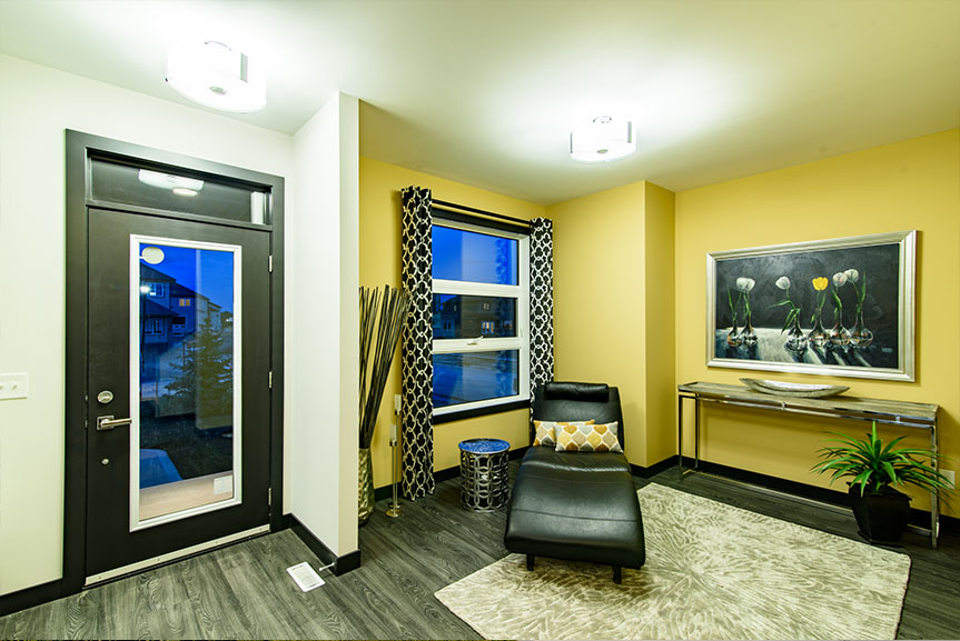 open concept from entrance with vinyl plank flooring and yellow accent walls