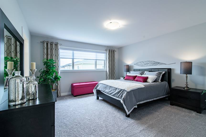 Modern Master Bedroom with clean lines and fuchsia accents, grey walls, black furniture and Villanow Twist carpet