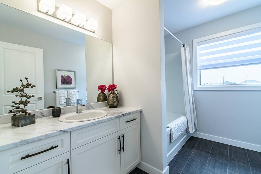 Modern upper main bathroom with Chelsea Grey fibrefloor, Wilsonart Calcutta marble laminate vanity tops with full eased edge
