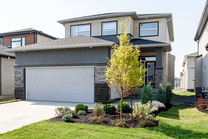Modern 2-storey home front exterior with cultured stone, Greenwich Village stucco, Dulux Grimmy's Grey textured acrylic stucco and black smart start trim