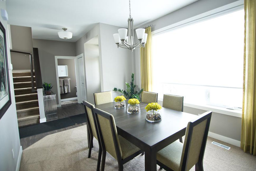 Contemporary Dining Room with Carpet, Grey Walls and Yellow Accents