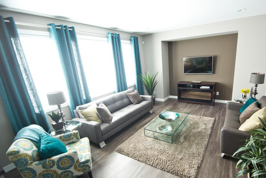 Contemporary Great Room with Vinyl Plank Flooring, Grey Walls and Teal Accents