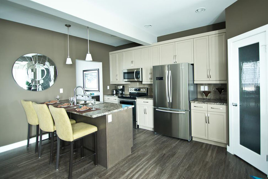Contemporary kitchen With Vinyl Plank Flooring, White Cabinets, Island and Stainless Steel Appliances
