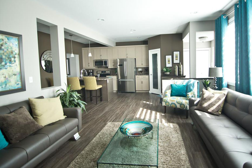 Contemporary Great Room and Kitchen with Vinyl Plank Flooring, Grey Walls and Teal Accents