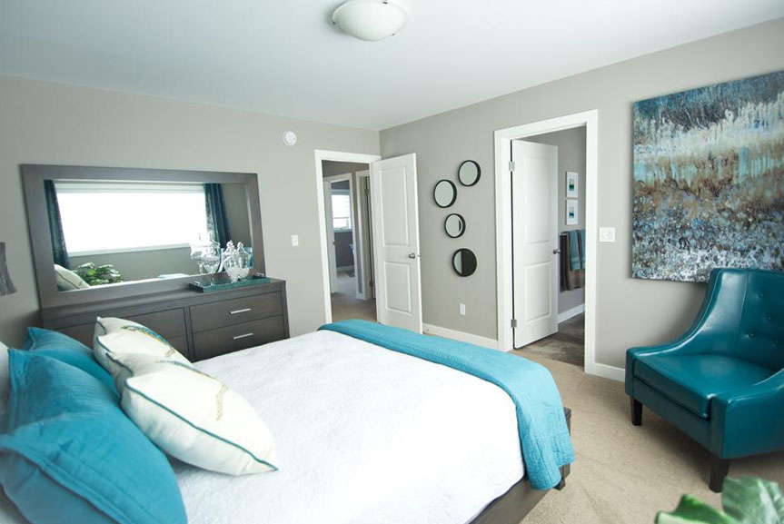 Contemporary Master Bedroom with Grey Walls and Blue and Teal Accents