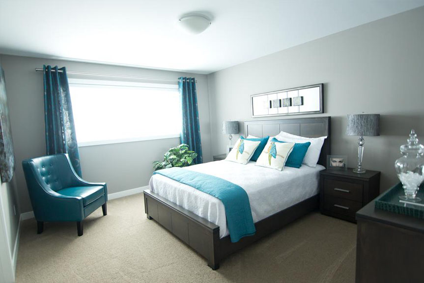 Contemporary Master Bedroom with Grey Walls, Teal Accents and Dark Furniture