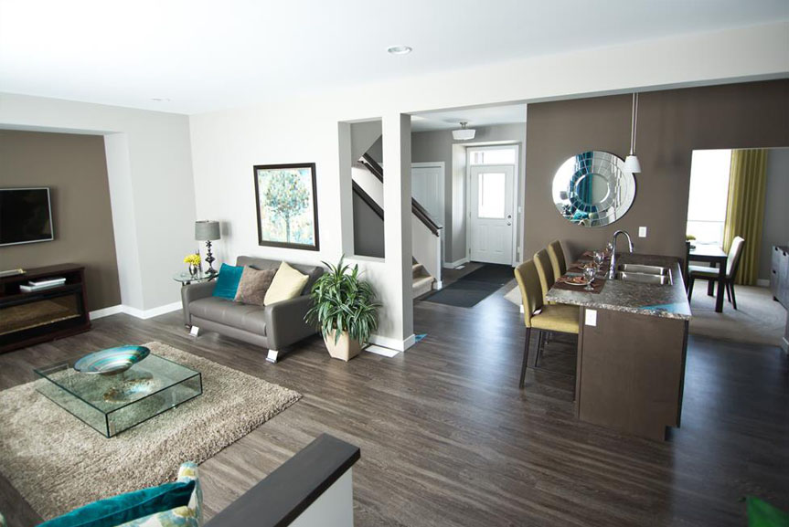 Contemporary Open Concept Main Floor with Vinyl Plank Flooring, Grey Walls and Teal Accents