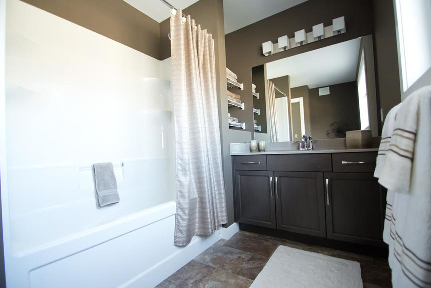 Contemporary Bathroom with Vinyl Flooring and Dark Wood Vanities