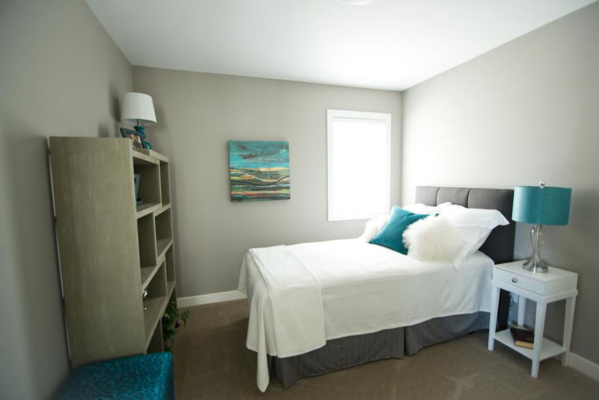 Contemporary Grey Bedroom with Teal Accents