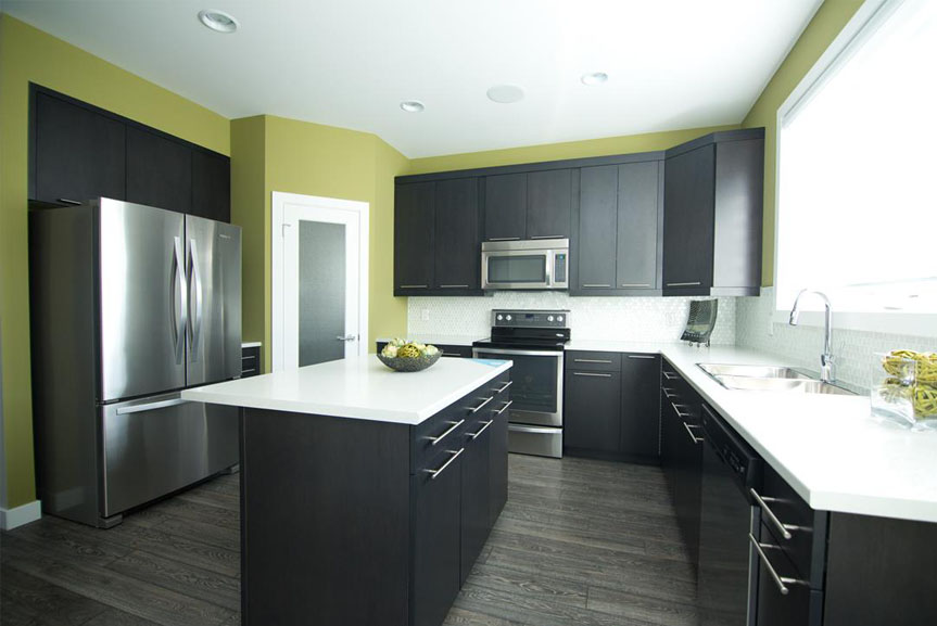 Contemporary Kitchen with Dark Cabinets, White Counter Tops and Stainless Steel Appliances