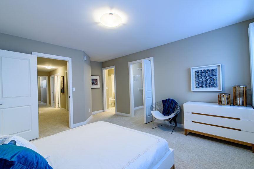 Modern and large Master bedroom with walk-in closet and ensuite, Gilman's Glory Fine Lace carpet and beige walls