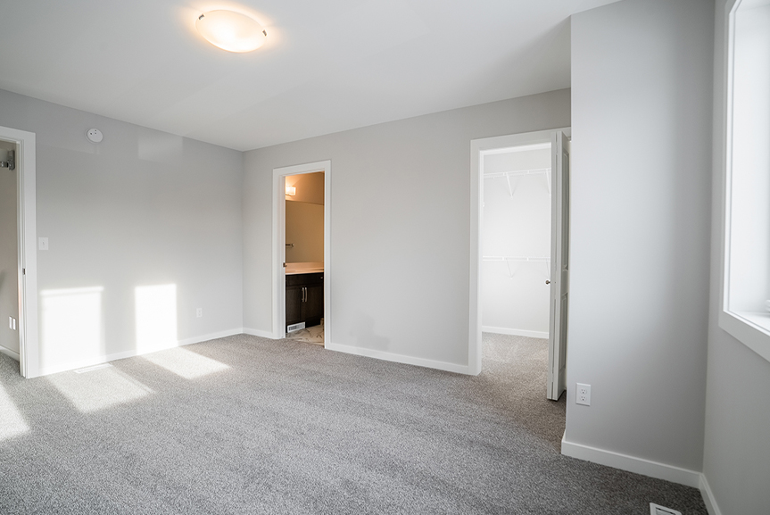 13. Master Bedroom with grey carpet, light grey painted walls and white casing and baseboards - 159 Atlas Crescent The Highview DG 43 A Broadview Homes