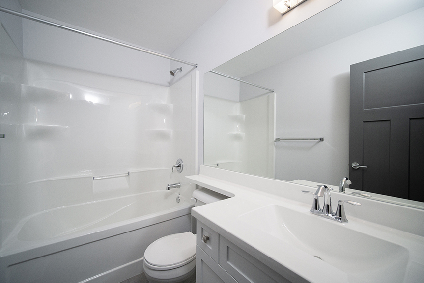 11. Main Bathroom with white cabinets, white cultured marble vanity tops. light grey walls and acrylic 1-piece shower - 221 Petryk Terrace Broadview Homes DG 15 A