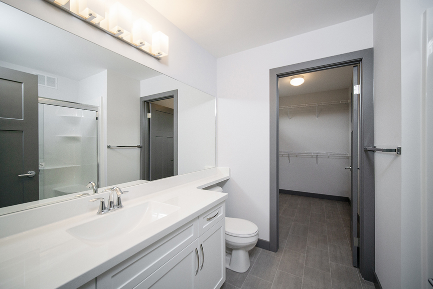15. Ensuite with white cabinets, white cultured marble vanity tops, grey walls and dark grey door trim - 221 Petryk Terrace Broadview Homes DG 15 A