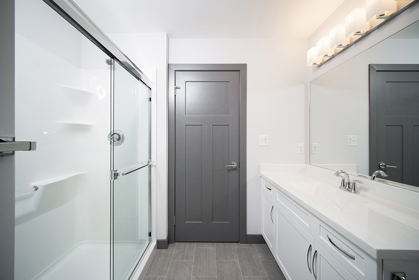16. Ensuite with white cabinets, white cultured marble vanity tops and dark grey door and trim- 221 Petryk Terrace Broadview Homes DG 15 A