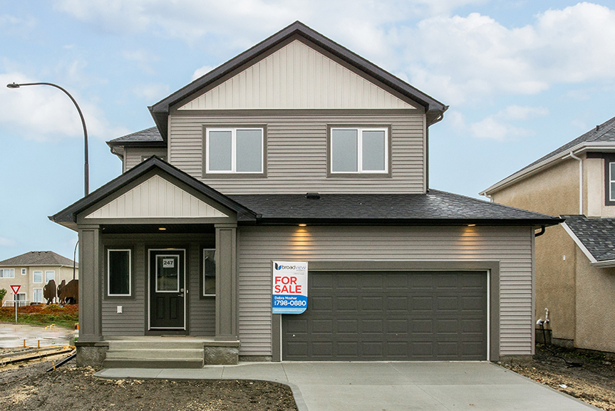 1. Front Exterior with grey vinyl siding and concrete front entrance with dark grey smart start pillars - 247 Joynson Crescent - Broadview Homes The Biscayne DG 14 A