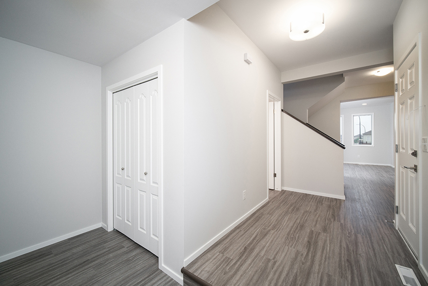 3. Front Foyer with grey vinyl plank flooring, light grey walls and white door trim- 247 Joynson Crescent - Broadview Homes The Biscayne DG 14 A