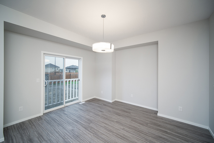 6. Eating Area with grey vinyl plank flooring, light grey walls and white casing and baseboards - 247 Joynson Crescent - Broadview Homes The Biscayne DG 14 A