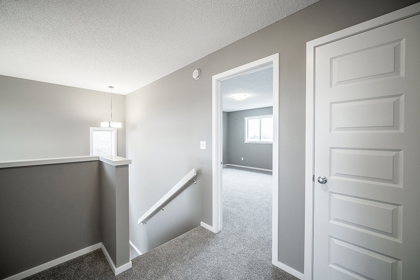 11. Second Floor Landing with grey carpet, white baseboards and white door casing, and light grey walls - 34 Grey Heron The Aurora DG 9 C Broadview Homes