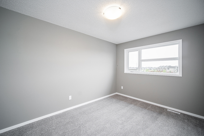 13. Secondary Bedroom with light grey carpet, white baseboards and white window casing and light grey walls - 34 Grey Heron The Aurora DG 9 C Broadview Homes