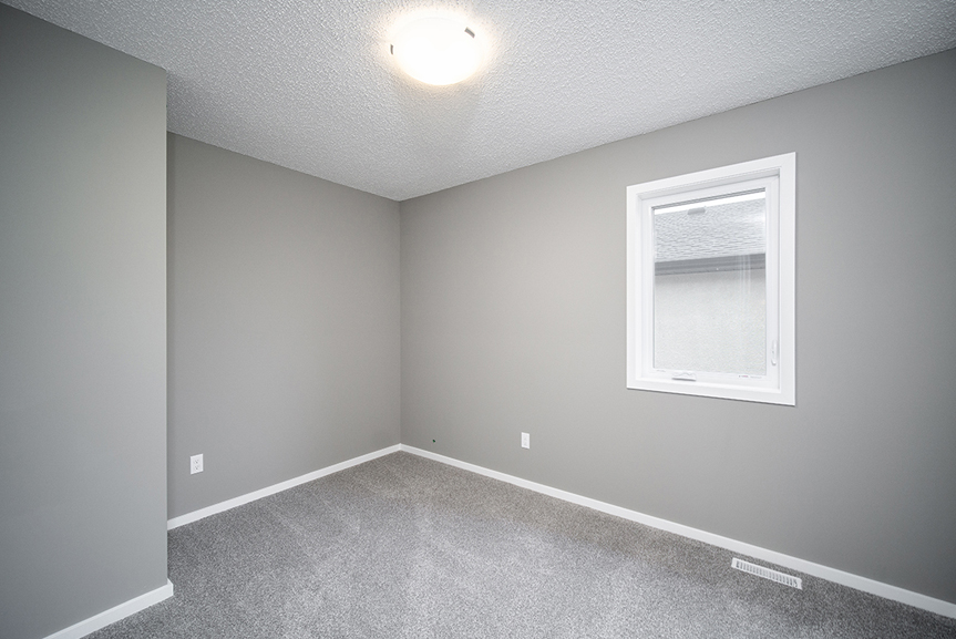 14. Secondary Bedroom with grey carpet, white baseboards, white window casing and grey walls - 34 Grey Heron The Aurora DG 9 C Broadview Homes