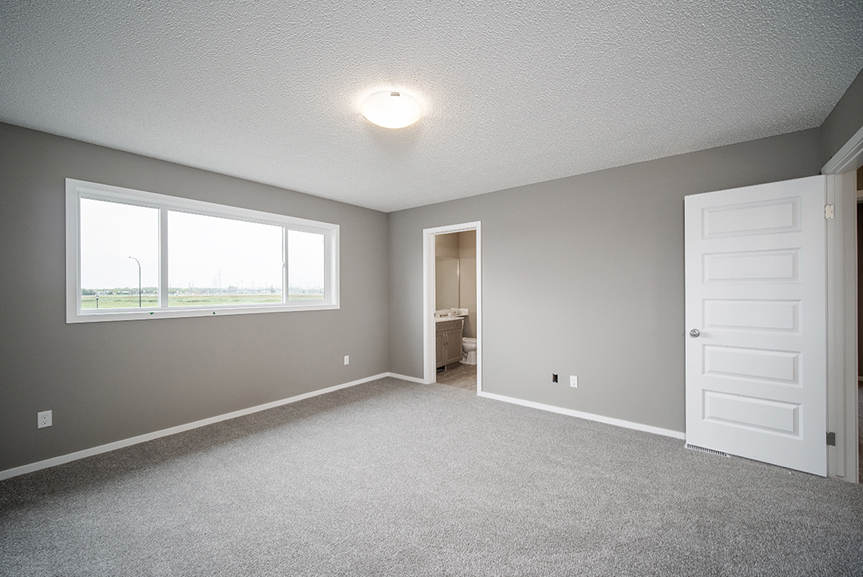 16. Master Bedroom with light grey carpet, white baseboards, white window casing, white doors, grey walls and large combination window - 34 Grey Heron The Aurora DG 9 C Broadview Homes