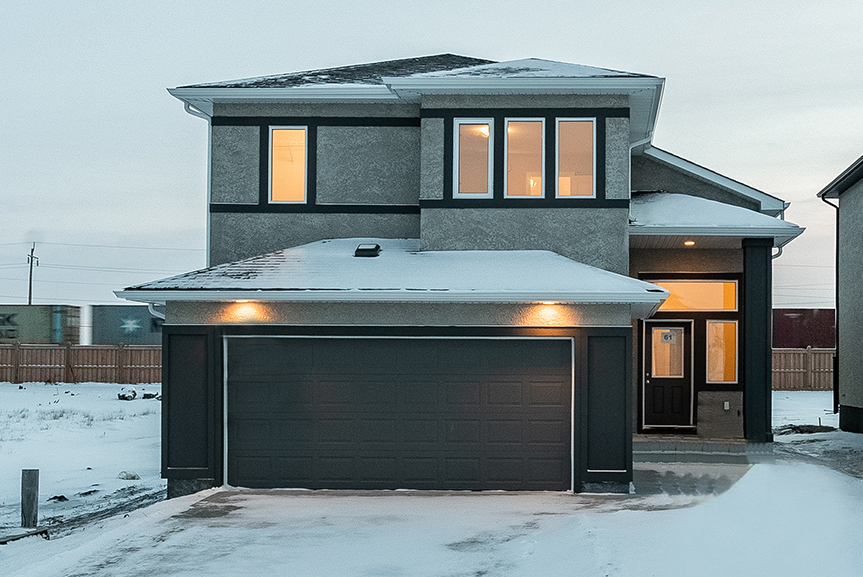 1. Front Exterior - 61 Kestrel Way The Highview DG 43 A Broadview Homes with dark grey smart start paneling and light grey stucco finish