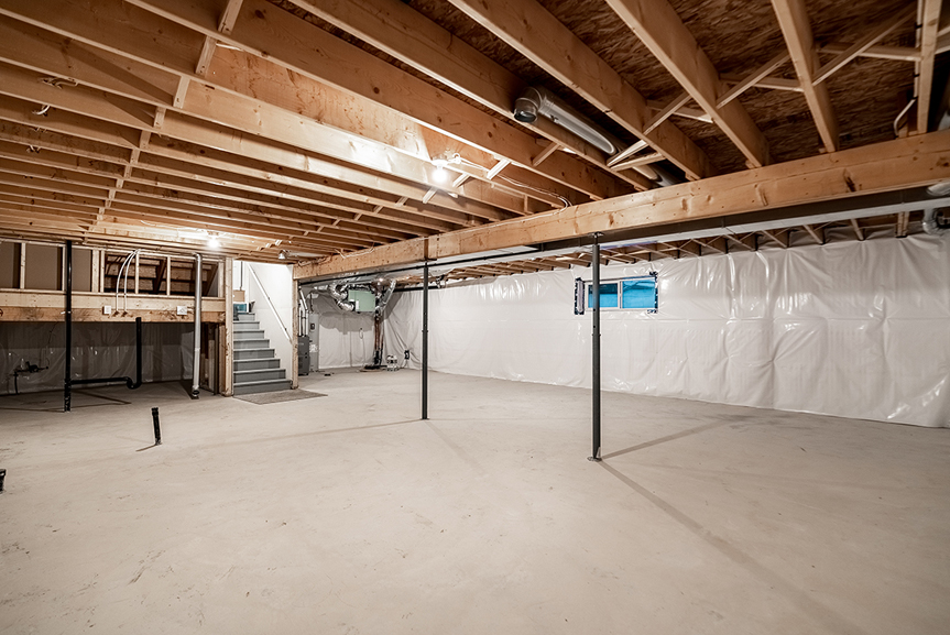 17. Lower Level - 61 Kestrel Way The Highview DG 43 A Broadview Homes with concrete flooring, teleposts and joists