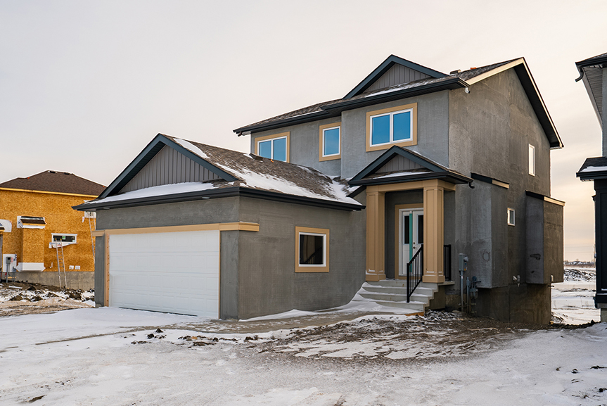 1. Exterior Photo with smart start trim and dark grey scratch coat - 62 Jack Reimer DG 18 C The Cottonwood Broadview Homes