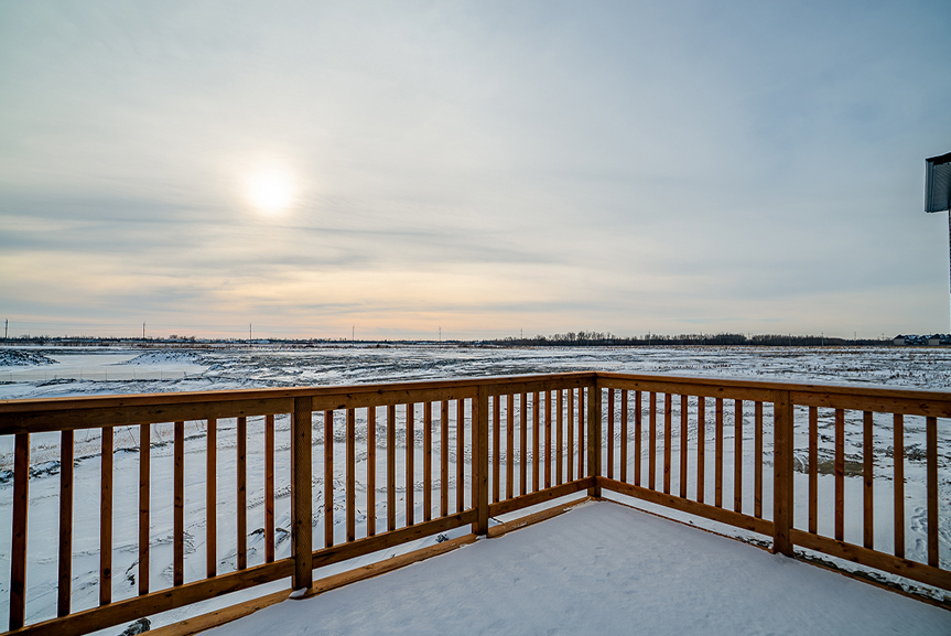 22. Rear Deck with wood railing and winter sunset - 62 Jack Reimer DG 18 C The Cottonwood Broadview Homes